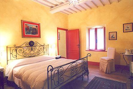 view of the bedroom in a tuscan villa